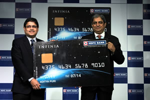 l-r-pralay-mondal-country-head-retail-assets-cr-cards-hdfc-bank_-hands-over-the-1st-indian-cr